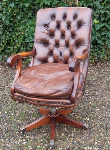 An Executive Brown Leather Swivel Chair - SOLD -