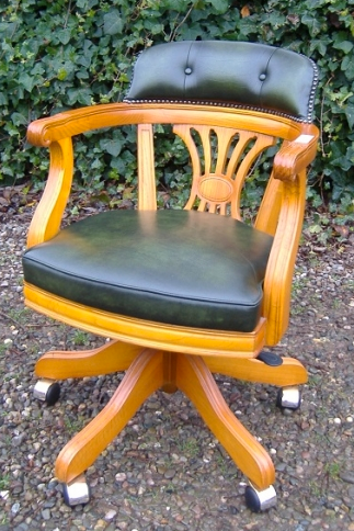 A Green Leather Executive Swivel Chair
