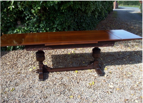 A Ten Seat Oak Extending Refectory Table
