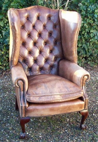 A Beige Leather Wing Chair