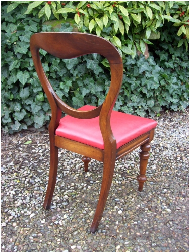 A Set of 8 Mahogany Balloon Back Chairs
