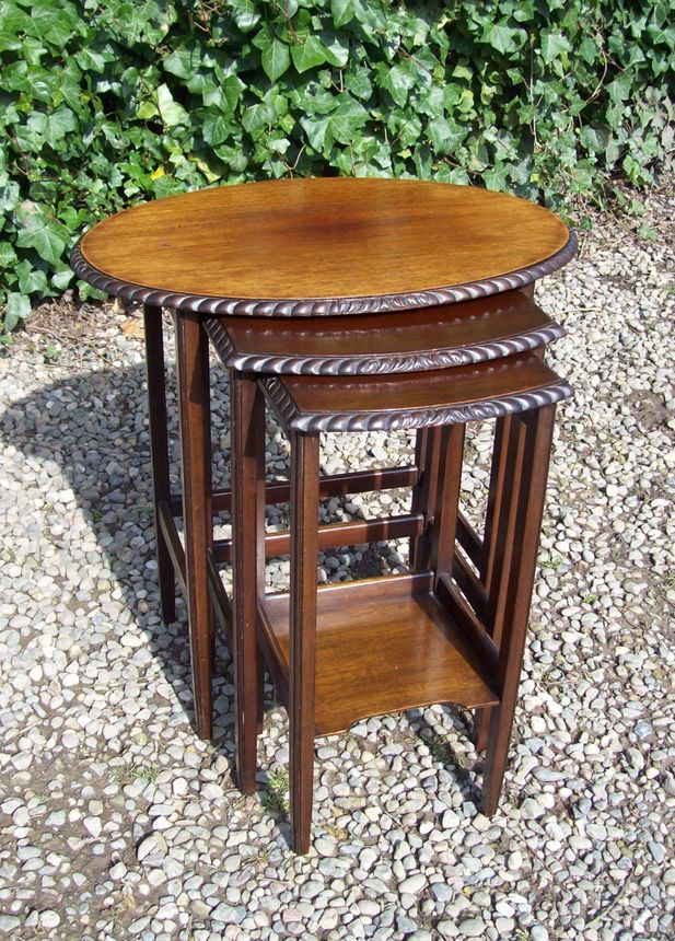 A Nest of Three Mahogany Tables