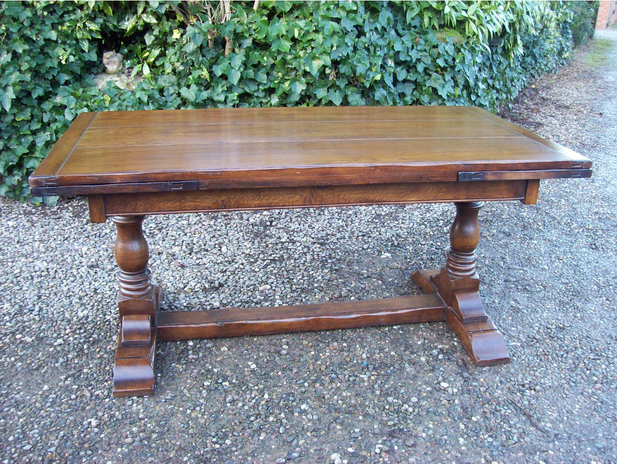 An Oak Extending Refectory Table -SOLD-