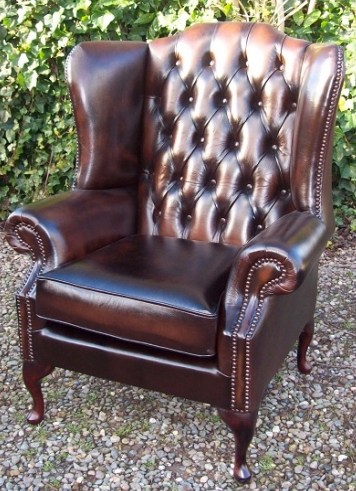 A Brown Leather Wing Chair -SOLD-