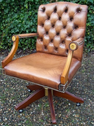 A Caramel Brown Leather Swivel Chair