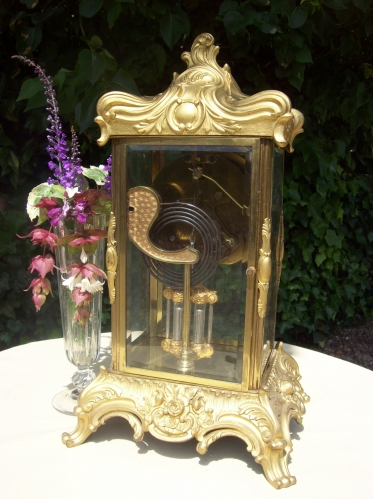 A French Ormolu Four Glass Clock